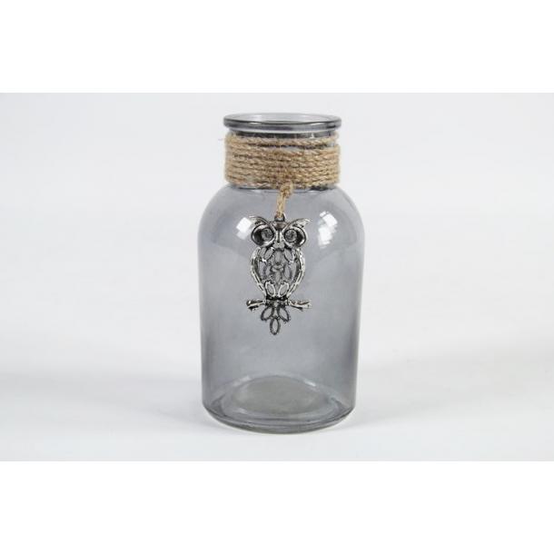 Glasflaske med emblem